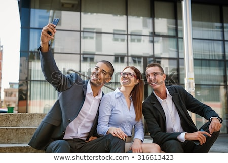Business Team Capturing Selfie Stock photo © HASLOO