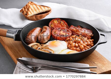 egg and mushrooms in a stack of frying pans stock photo © ozgur