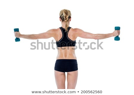 female bodybuilder holding two dumbbells with arms out stock photo © wavebreak_media