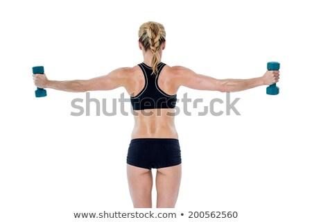 Női testépítő tart kettő súlyzók karok Stock fotó © wavebreak_media
