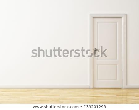Cerrado blanco puerta marrón pared piso de madera Foto stock © teerawit