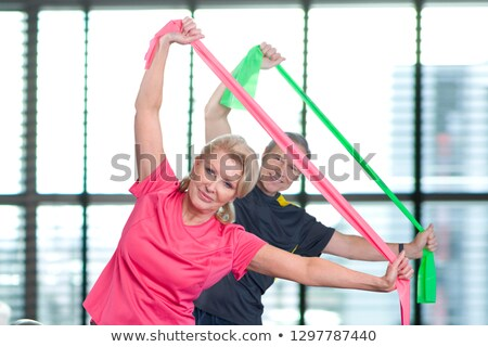 Happy people exercising with resistance bands in gym class Stock photo © wavebreak_media