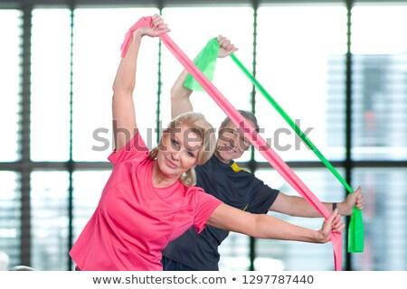 férfi · képzés · testmozgás · zenekar · fiatalember · női - stock fotó © wavebreak_media