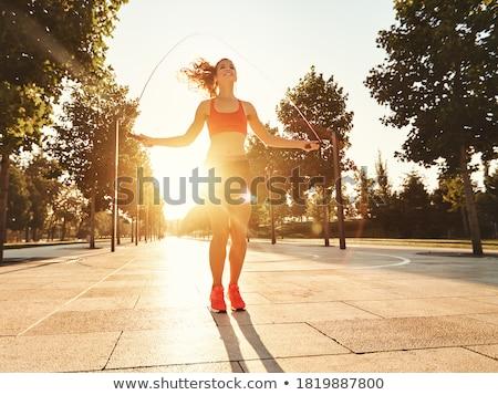 Energiczny młoda kobieta skoki liny fitness Zdjęcia stock © stryjek