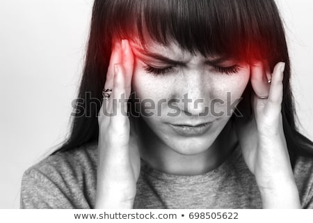 Pretty young woman with migraine over white Stock photo © Aikon
