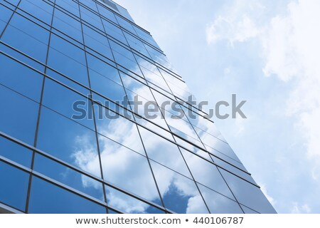 blue mirror glass facade skyscraper buildings stock photo © lunamarina