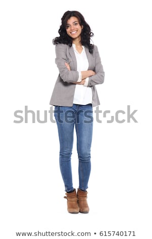 Happy woman standing with arms folded Stock photo © deandrobot