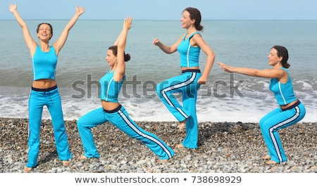smiling woman wearing sporty clothers is making exercise on sea coast stock photo © paha_l