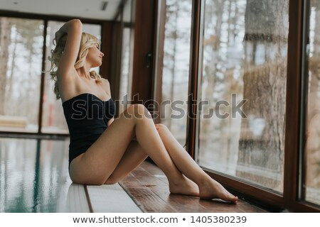 Woman sitting at swimming pool in winter  Stock photo © Kzenon