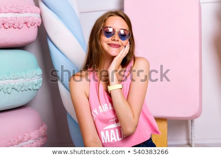 beautiful woman in sunglasses holding candy stock photo © deandrobot