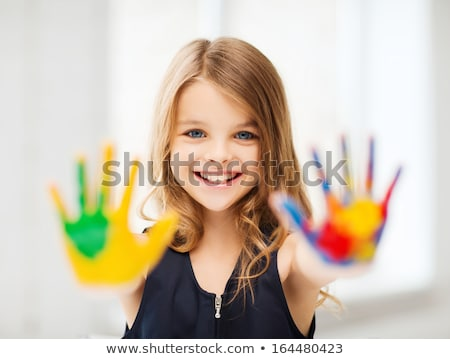 Creative little girl having fun with paint stock photo © ozgur