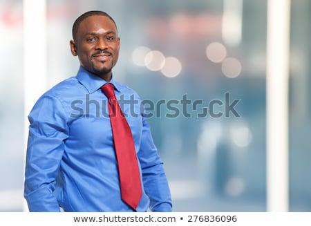 bearded businessman in blue shirt and red necktie stock photo © stevanovicigor