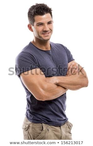 Vista lateral exitoso hombre guapo armas doblado pie Foto stock © deandrobot
