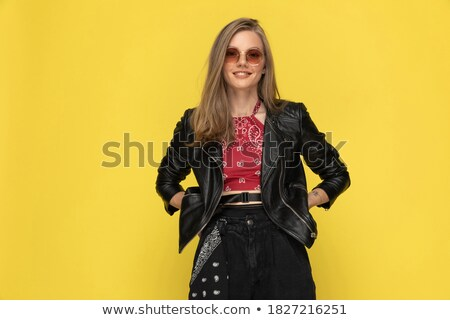 blonde woman in leather jacket holding hands on waist Stock photo © feedough