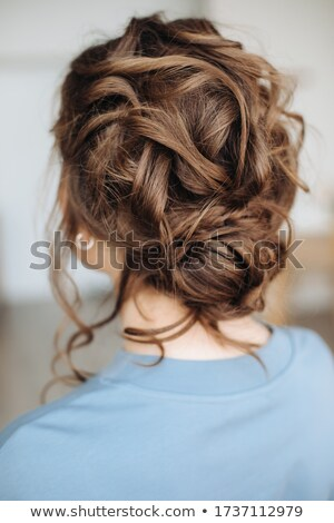 Young blonde woman with fabulous curly hairstyle Stock photo © konradbak
