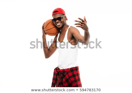 Cheerful african man holding basketball ball and inviting to play Stock photo © deandrobot