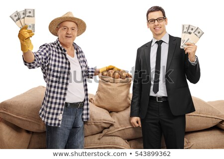 senior caucasian farmer holding a money bag stock photo © rastudio