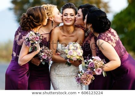 Bride and bridesmaids standing with bouquet Stock photo © wavebreak_media