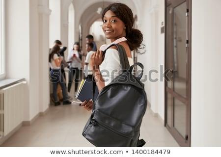 Imagem menina estudante mochila estudar compêndio Foto stock © deandrobot