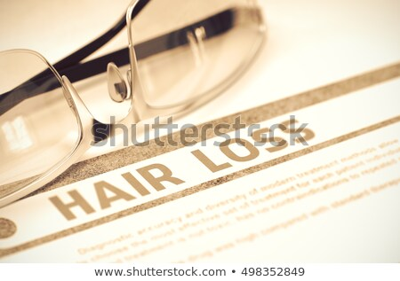 Hair loss - Printed Diagnosis on Red Background. Stock photo © tashatuvango