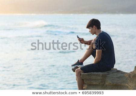 man reading on mountain top stock photo © is2