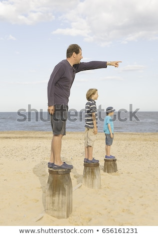 Man and children standing on groynes Stock photo © IS2