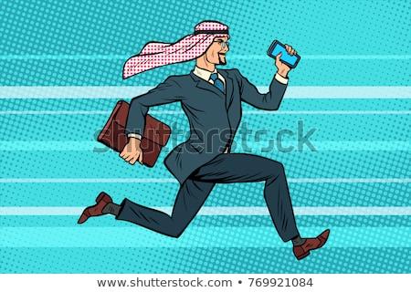 Arab imprenditore inoltrare telefono valigetta mano Foto d'archivio © studiostoks