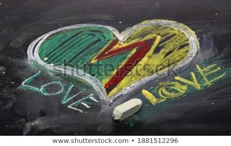 i love school heart symbol as a chalkboard text is written in stock photo © popaukropa