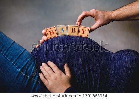 kaukázusi · terhes · nő · fakockák · pocak · fából · készült · játszik - stock fotó © monkey_business