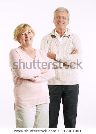 Senior couple embracing against white background Stock photo © IS2