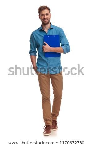 Młodych przypadkowy student naprzód notatnika Zdjęcia stock © feedough