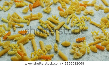 Different macaroni laid in disorder Stock photo © dash