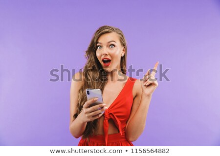Image closeup of joyous excited woman 20s wearing red dress smil Stock photo © deandrobot