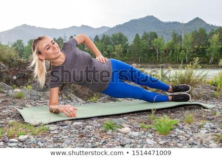 woman making yoga in side plank pose outdoors Stock photo © dolgachov