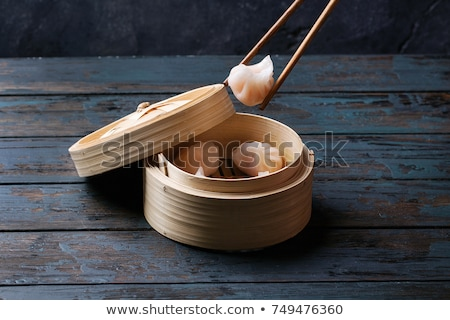 Delicious chinese dumplings served in wooden bamboo steamer Stock photo © dash
