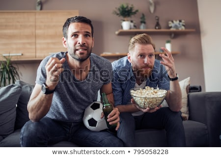 two friends watching football on the couch and drinking beer vector isolated illustration stock photo © pikepicture