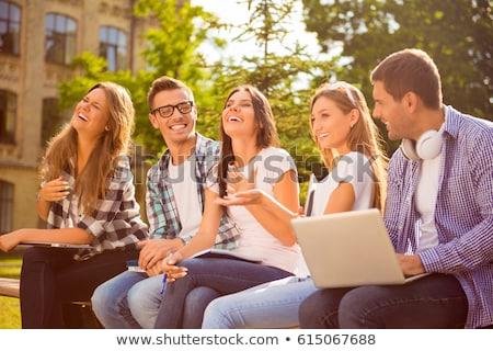 счастливым молодые друзей улице парка Сток-фото © deandrobot