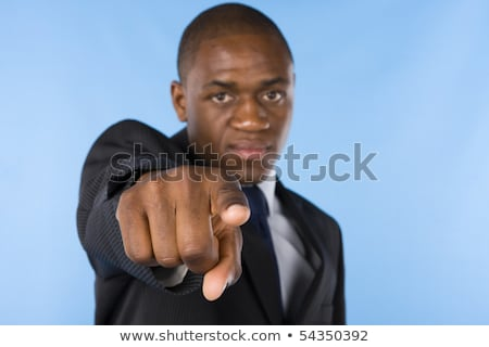 african businessman at office pointing at you stock photo © dolgachov