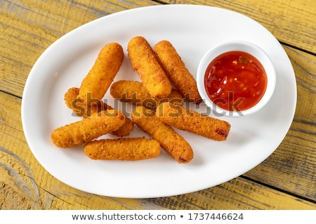 Brie fritters on the white plate Stock photo © Alex9500
