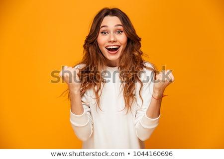 Belle heureux jeune femme isolé jaune Photo stock © deandrobot