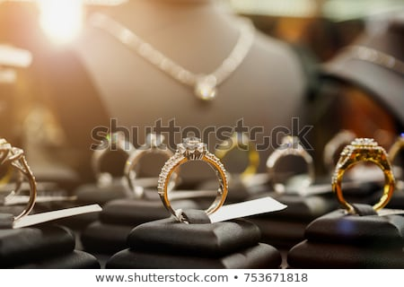 Earrings Set Gold Accessory on Black Display Set Stock photo © robuart