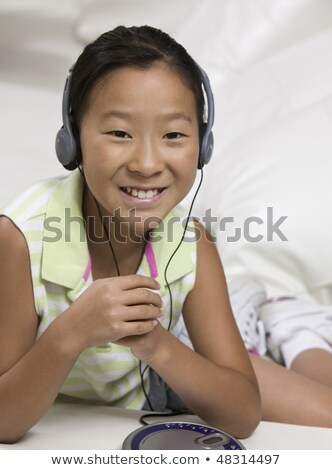 Dziewczyna rok starych słuchanie muzyki sofa kobieta Zdjęcia stock © Lopolo
