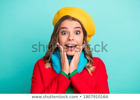 portrait of an astonished young woman wearing beret stock photo © deandrobot