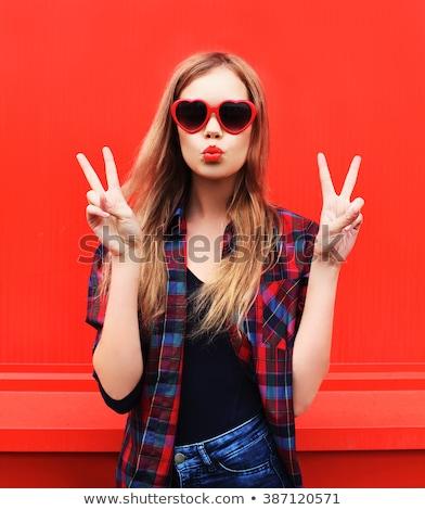 happy teenage girl in sunglasses stock photo © dolgachov
