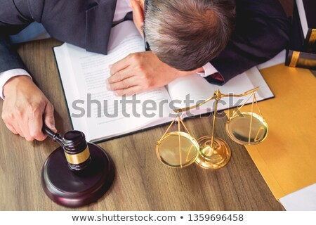 lawyer tried or stress from hard working. Stock photo © snowing