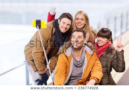 teenage girls taking picture by selfie stick Stock photo © dolgachov