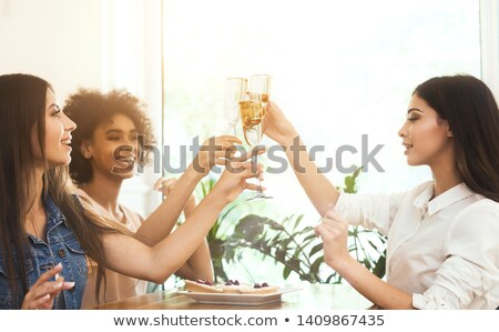 Young woman holding champagne glass Stock photo © Kzenon