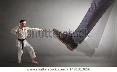 Grande pé pequeno karatê homem jovem Foto stock © ra2studio