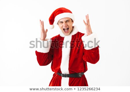 Portrait of ecstatic man 30s in santa claus costume and red hat  Stock photo © deandrobot