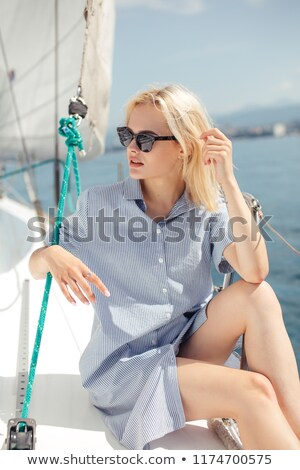 fashion outdoor photo of beautiful woman with blond hair in elegant clothes walking by the antic ita Stock photo © ElenaBatkova
